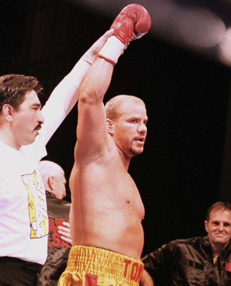 Tommy Morrison raises his hand helped by Mexican referee Frank Garza, wearing a rubber glove, after Morrison defeated Marcus Rohode in their bout in Urayasu, a Tokyo suburb, Nov. 3, 1996. HIV-infected Morrison knocked out Rohode in the first round of the bloodless fight. Photo: TSUGUFUMI MATSUMOTO, AP / AP