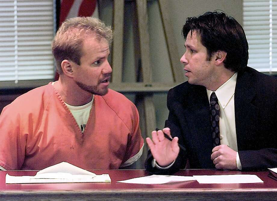 Former heavyweight boxing champion Tommy Morrison, left, consults with his attorney Rusty Hudson before pleading guilty to drug charges in Washington County Circuit Court in Fayetteville, Ark. Friday Jan. 14, 2000.  Morrison was sentenced to two years in prison. Photo: PHILLIP WALROD, AP / NORTHWEST ARKANSAS TIMES