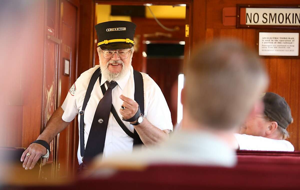 Volunteer conductor Paul Trimble regales passengers with train history aboard an electric train which was part of the Sacramento Northern Railroad, near Rio Vista, Calif., on Saturday, August 31, 2013. The rail line celebrates its 100th anniversary on Sept. 3.
