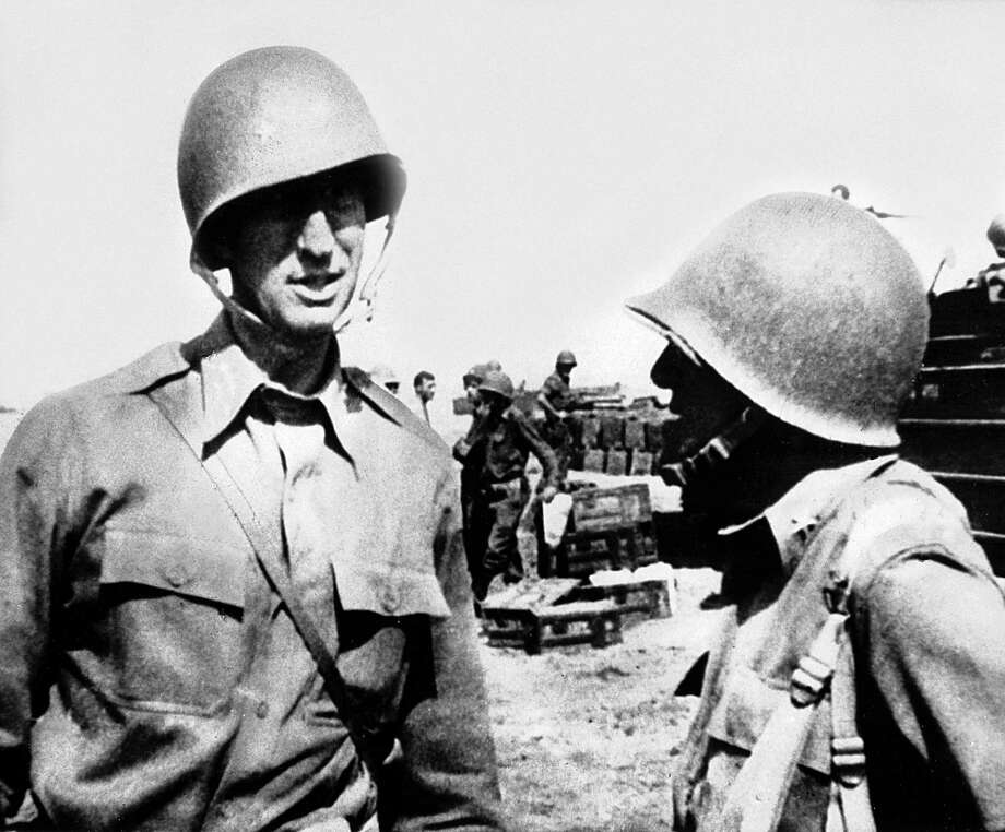 The Commander of the US, Fifth Army, Lieutenant General Mark W, Clark on the beach near Salerno where his troops invaded Italy, chats with another officer (September 1943). Photo: UniversalImagesGroup, Getty Images / Universal Images Group Editorial