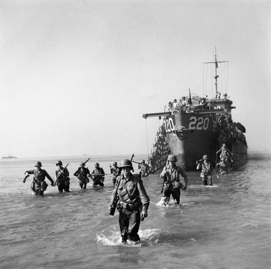 American troops wading ashore from a landing craft during the World War II Allied invasion of Salerno, Italy, September 1943. Photo: George Rodger, Getty Images / 2007 Getty Images