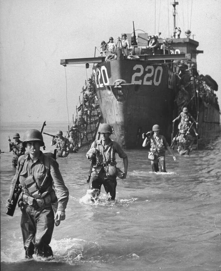 American troops wading ashore from landing craft during the Allied invasion of Salerno, Italy. Photo: George Rodger, Getty Images / Time Life Pictures