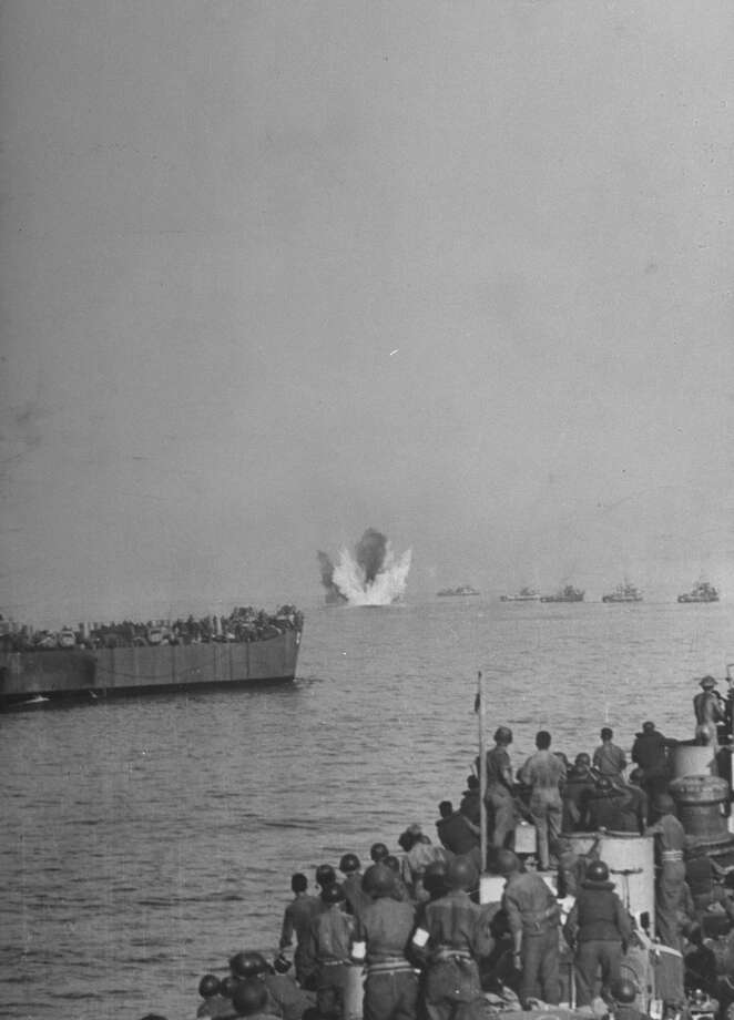Bomb from high flying German plane explodes amidst convoy of American landing craft heading to invade mainland Italy at Salerno, September 1943. Photo: George Rodger, Getty Images / Time Life Pictures