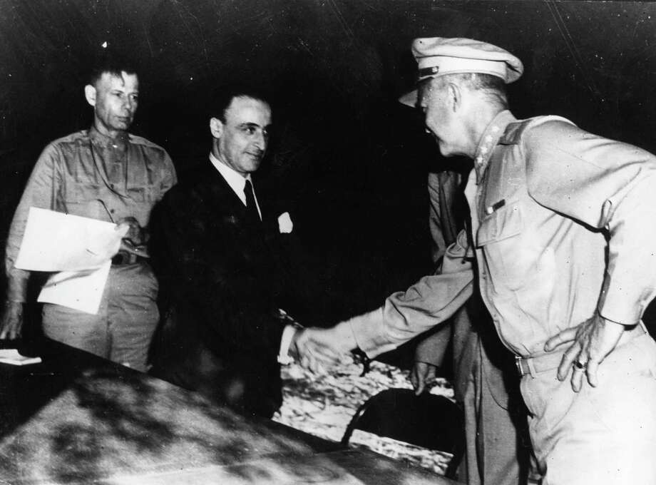 General G Castellano, representing Italy, receives a handshake from General Dwight D Eisenhower, supreme commander of Allied Forces, after the ceremony of signing the Italian armistice papers had been completed. General Walter Bedell Smith watches the proceedings on the left. Eisenhower was later elected the 34th President of the United States. Photo: Keystone, Getty Images / Hulton Archive