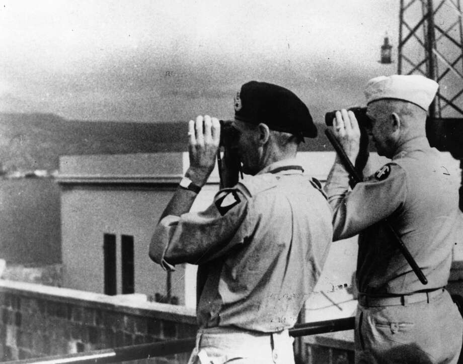 British soldier Field Marshall Bernard L Montgomery (1887 -1976), commander of the Eighth Army, and the American soldier General Dwight D Eisenhower (1890 - 1969) at Messina, study the Italian mainland through binoculars. They were making final preparations for the assault across the Straits of Messina, accomplished by British and American forces on September 3, 1943. Eisenhower was later elected the 34th President of the United States. Photo: Keystone, Getty Images / Hulton Archive