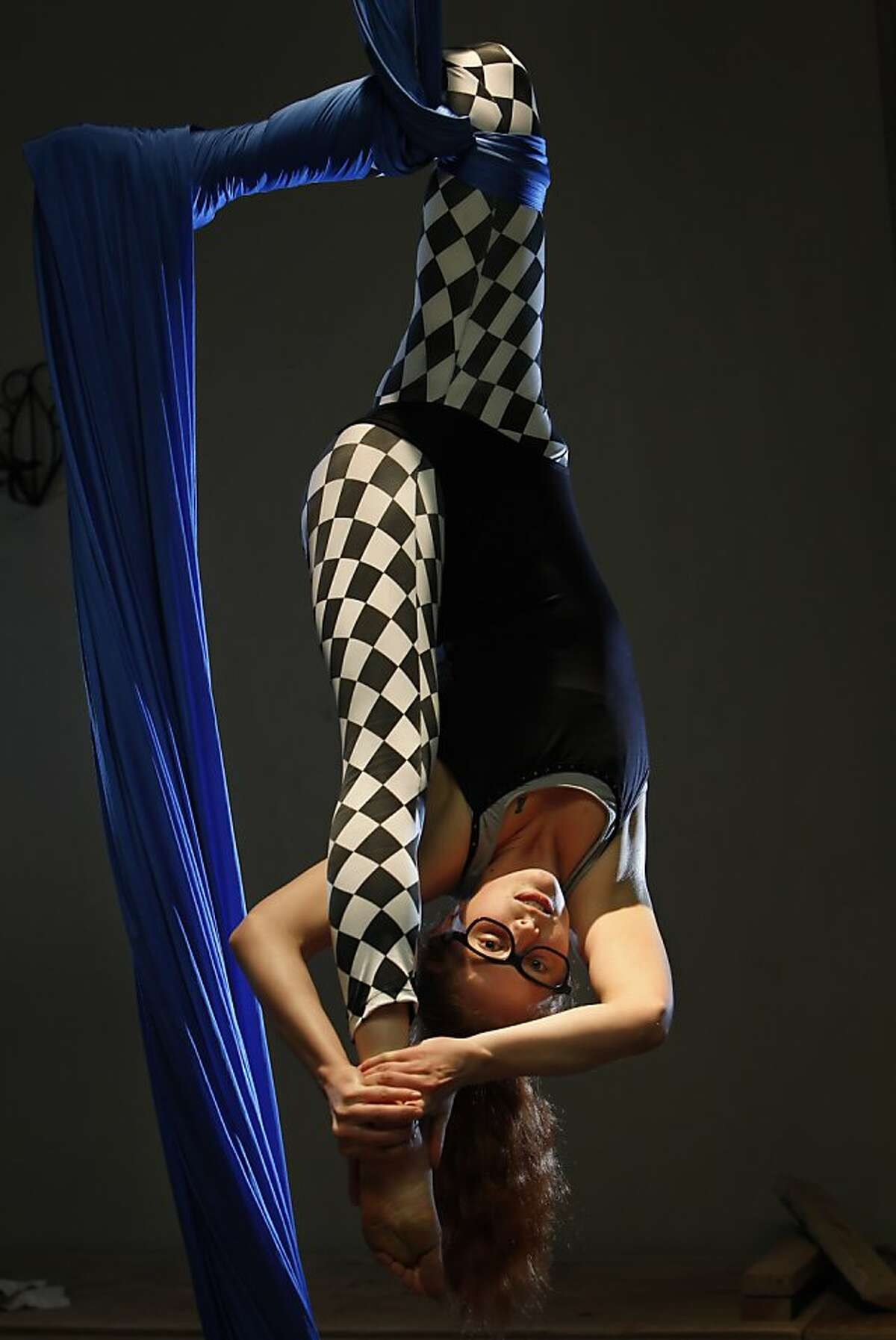 Bunny Zlotnik performs on aerial fabric during rehearsal of the Vespertine Circus in Oakland, Calif., on Tuesday, April 30, 2013. Oakland has become a major hub for circus arts. People come from all over the world to study in haphazard, organic