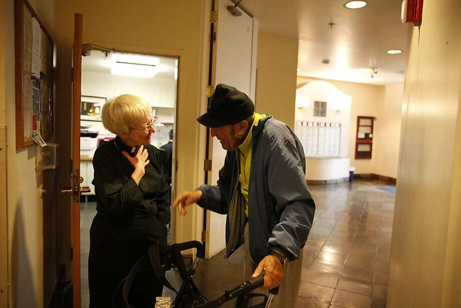 The Rev. Glenda Hope visits with Yuri Dubrovsky at a low-income housing complex on Ellis Street. Hope ministered in the Tenderloin for 41 years. Photo: Lea Suzuki, The Chronicle
