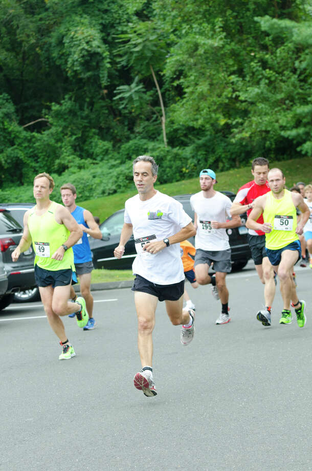 Peter Hohmeister and a pack of runners begin the race during the sixth annual 5k Run/Walk and Family Fun Day to benefit JumpStart at the Stamford Jewish Community Center (JCC) on Newfield Avenue in Stamford on Monday, Sept. 2, 2013. Photo: Amy Mortensen / Connecticut Post Freelance