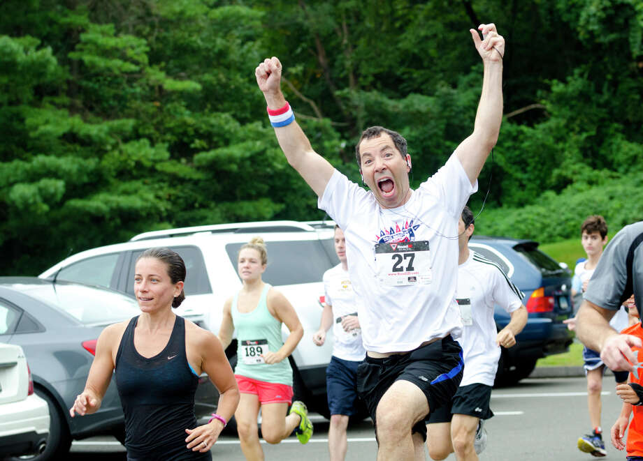 Scott Piskin, of Stamford, cheers at the start of the race during the sixth annual 5k Run/Walk and Family Fun Day to benefit JumpStart at the Stamford Jewish Community Center (JCC) on Newfield Avenue in Stamford on Monday, Sept. 2, 2013. Photo: Amy Mortensen / Connecticut Post Freelance