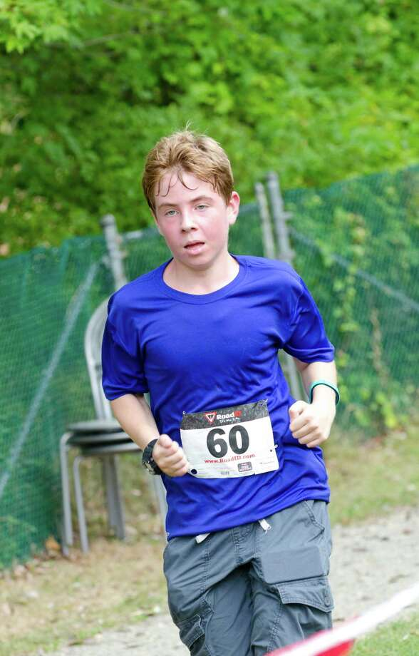 Ben Adams, 14, of Stamford, competes during the sixth annual 5k Run/Walk and Family Fun Day to benefit JumpStart at the Stamford Jewish Community Center (JCC) on Newfield Avenue in Stamford on Monday, Sept. 2, 2013. Photo: Amy Mortensen / Connecticut Post Freelance