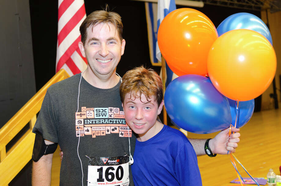 Jonathan Adams and his son, Ben, 14, of Stamford, pose for a photo after finishing the race during the sixth annual 5k Run/Walk and Family Fun Day to benefit JumpStart at the Stamford Jewish Community Center (JCC) on Newfield Avenue in Stamford on Monday, Sept. 2, 2013. Photo: Amy Mortensen / Connecticut Post Freelance
