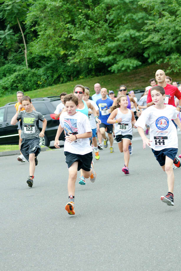 The sixth annual 5k Run/Walk and Family Fun Day to benefit JumpStart at the Stamford Jewish Community Center (JCC) on Newfield Avenue in Stamford on Monday, Sept. 2, 2013. Photo: Amy Mortensen / Connecticut Post Freelance