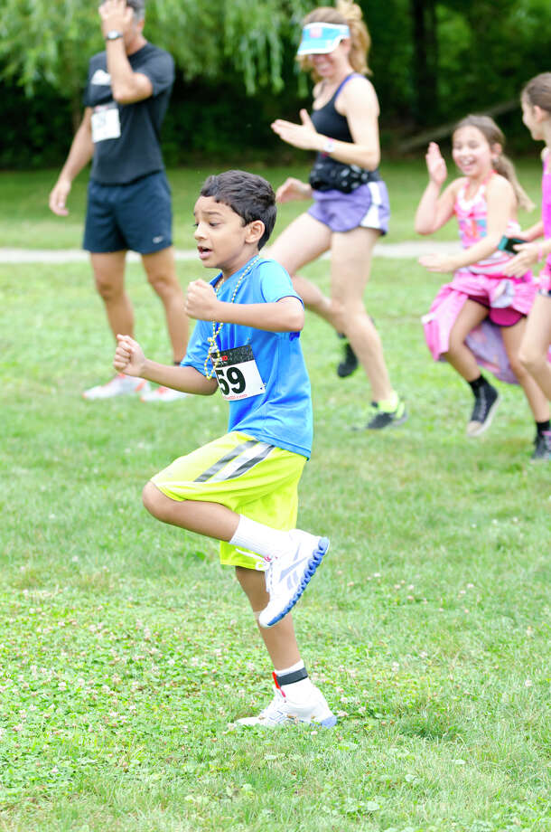 Rohan Sarma, 8, of Stamford, warms up during the sixth annual 5k Run/Walk and Family Fun Day to benefit JumpStart at the Stamford Jewish Community Center (JCC) on Newfield Avenue in Stamford on Monday, Sept. 2, 2013. Photo: Amy Mortensen / Connecticut Post Freelance