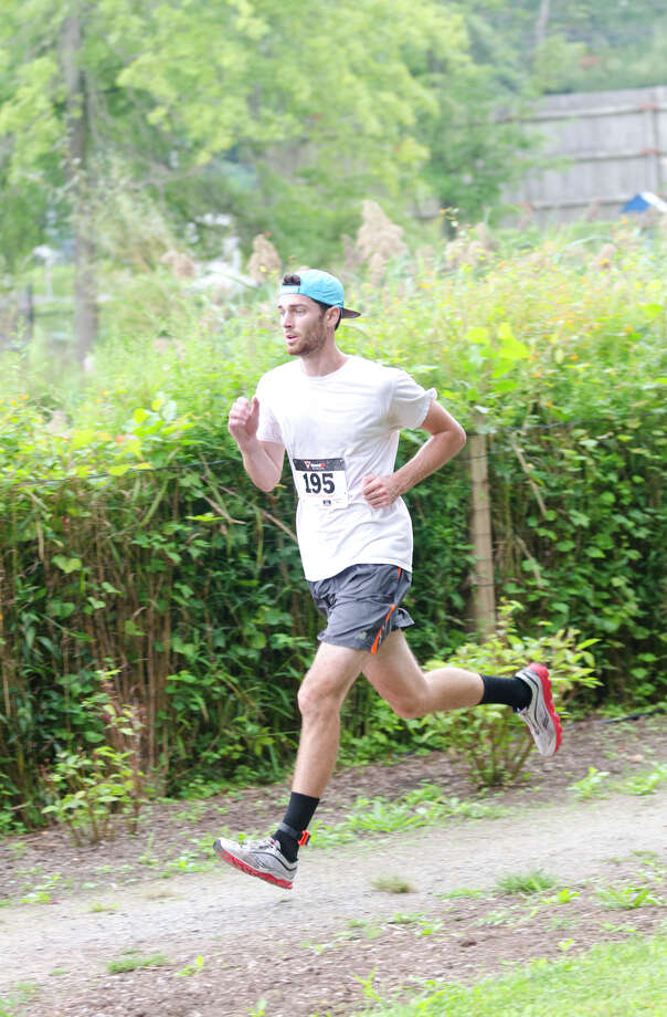 Patrick Galvin finishes first during the sixth annual 5k Run/Walk and Family Fun Day to benefit JumpStart at the Stamford Jewish Community Center (JCC) on Newfield Avenue in Stamford on Monday, Sept. 2, 2013. Photo: Amy Mortensen / Connecticut Post Freelance