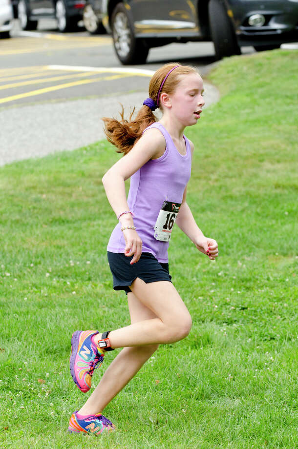 Carly Fein, 10, of Stamford, heads to the finish line during the sixth annual 5k Run/Walk and Family Fun Day to benefit JumpStart at the Stamford Jewish Community Center (JCC) on Newfield Avenue in Stamford on Monday, Sept. 2, 2013. Photo: Amy Mortensen / Connecticut Post Freelance