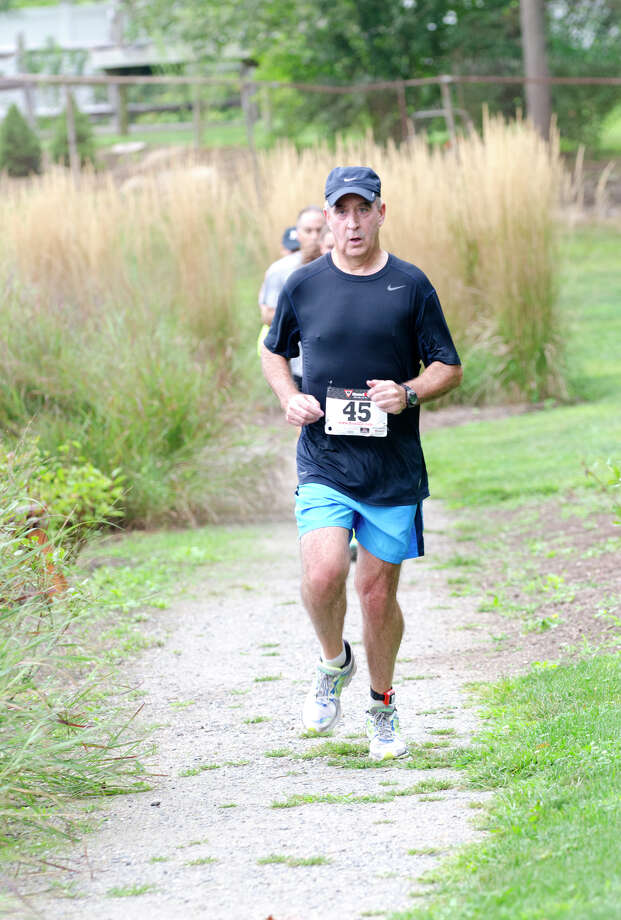 Patrick Barrett competes during the sixth annual 5k Run/Walk and Family Fun Day to benefit JumpStart at the Stamford Jewish Community Center (JCC) on Newfield Avenue in Stamford on Monday, Sept. 2, 2013. Photo: Amy Mortensen / Connecticut Post Freelance