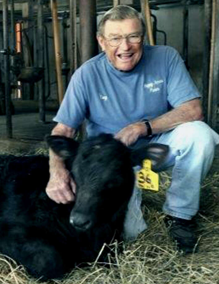 Tony Hapanowich, 85, shown here several years ago at Happy Acres Farm in Sherman with a Black Angus calf, died Wednesday, Aug. 28, 2013. Photo: Carol Kaliff