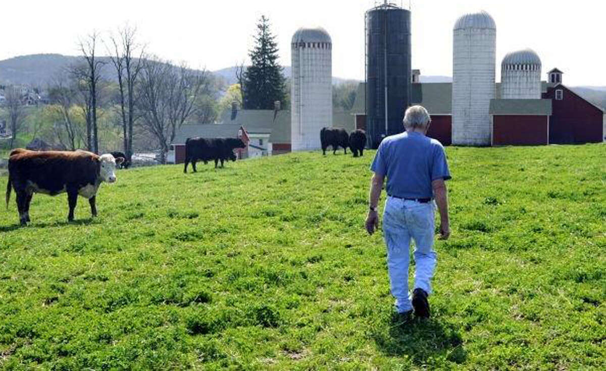 Tony Hapanowich, 85, shown here several years ago walking Happy Acres Farm in Sherman, died Wednesday, Aug. 28, 2013.