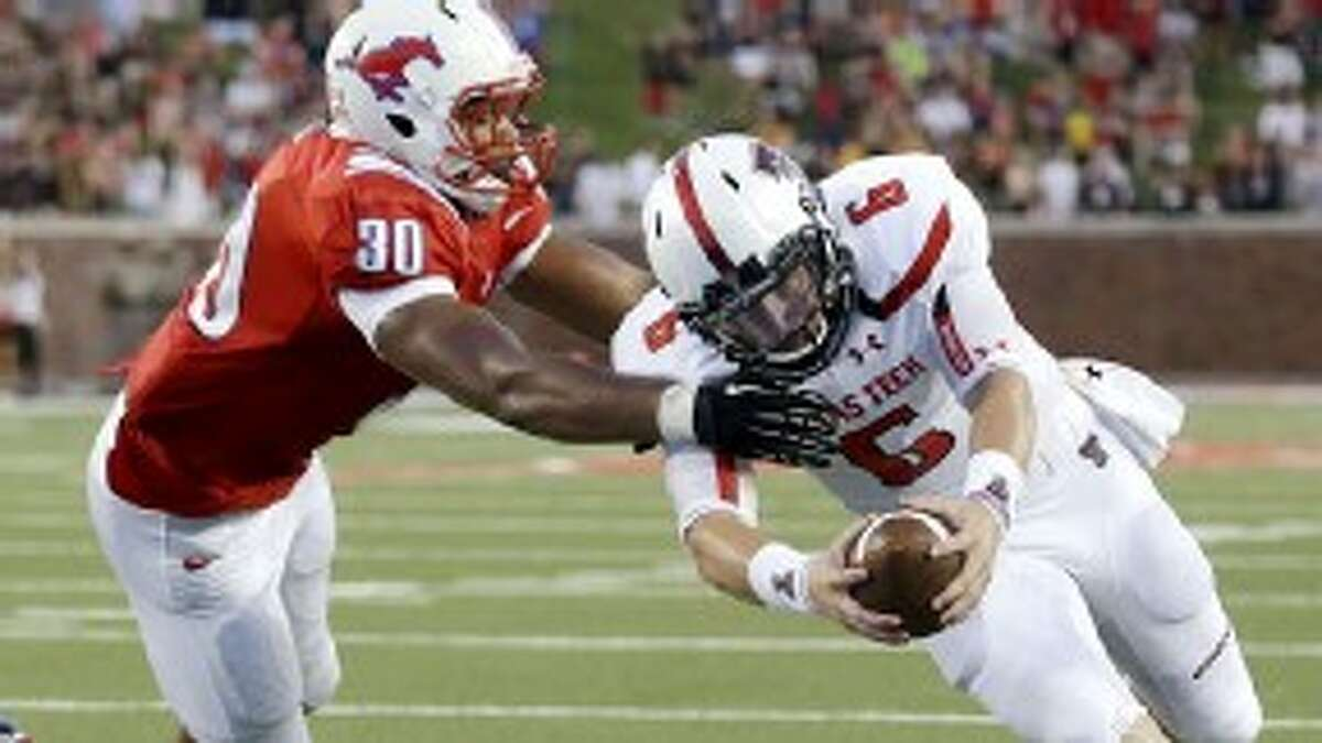 Texas Tech quarterback Baker Mayfield (6) runs against SMU linebacker Robert Seals (30) during the first half of an NCAA college football game, Friday, Aug. 30, 2013, in Dallas.