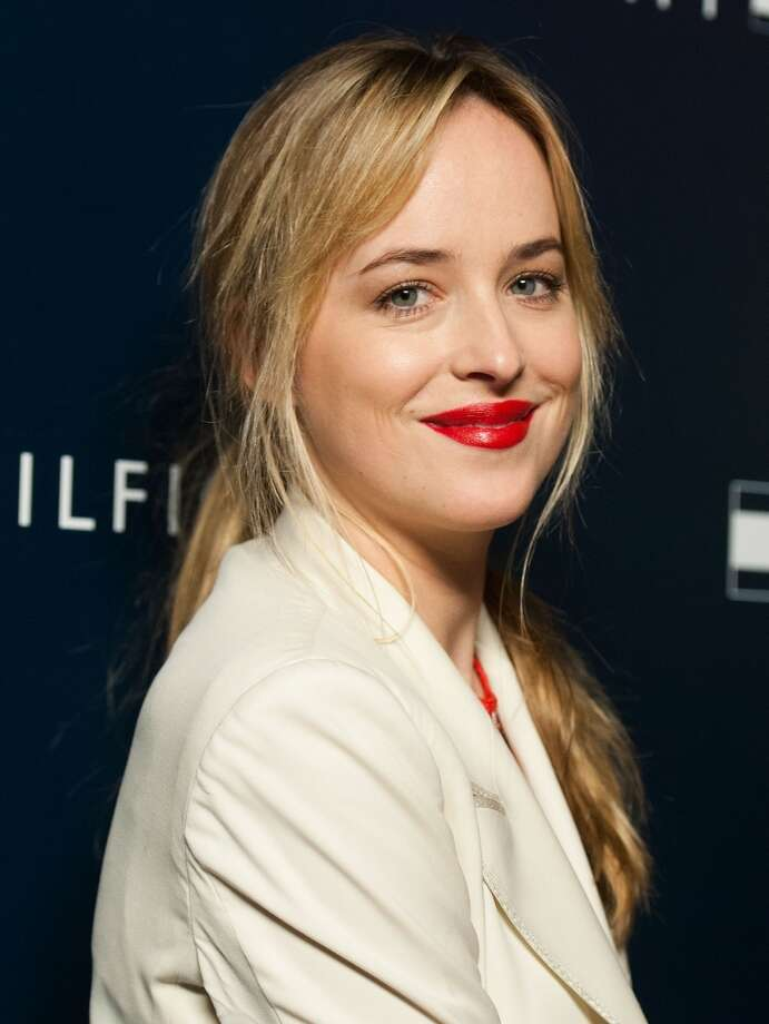 Dakota Johnson arrives at the  Tommy Hilfiger LA Flagship Opening on February 13, 2013 in Los Angeles, California. (Photo by Valerie Macon/Getty Images) Photo: Valerie Macon, Getty Images