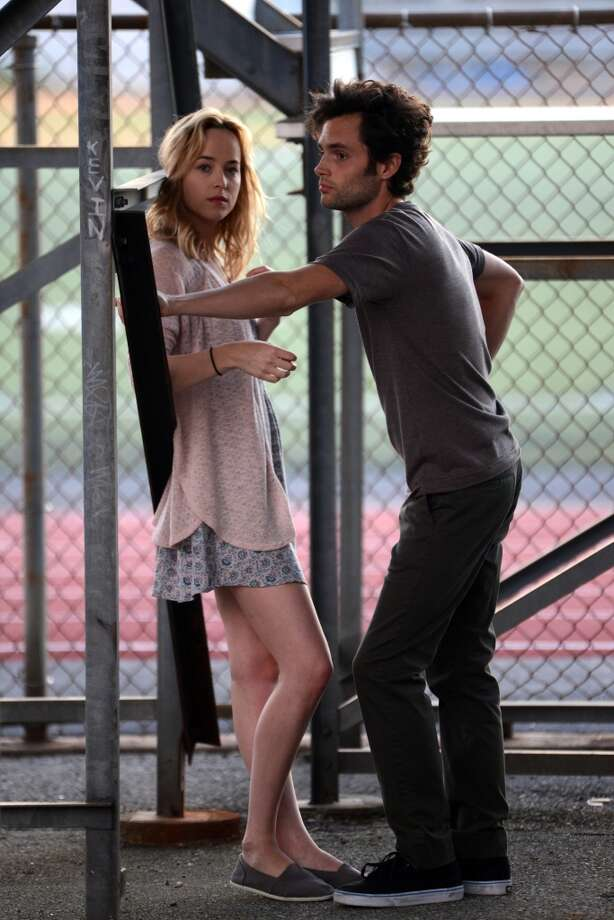 "Penn Badgley , Dakota Johnson (daughter of Melanie Griffin and Don Johnson ) filming Shakespiere's ""Cymbeline"" set in modern times on August 24, 2013 in Brooklyn, Ny.  (Photo by Steve Sands/Getty Images) Photo: Steve Sands, Getty Images"