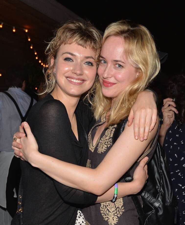 Imogen Poots (L) and Dakota Johnson attend Soho House New York's 10th birthday celebration with a live performance by Mumford and Sons on the roof top at Soho House on August 22, 2013 in New York City.  (Photo by Andrew H. Walker/Getty Images for Soho House) Photo: Andrew H. Walker
