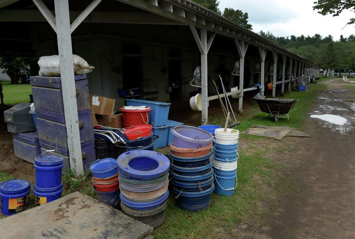 Feed tubs, water buckets and storage containers are readied for shipping from trainer David Jacobson's barn as the 150th meeting comes to a close Sept. 2, 2013, at the Saratoga Race Course in Saratoga Springs, N.Y. (Skip Dickstein/Times Union)