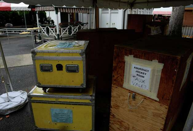Shipping cases are stacked under an canopy from the jockey's room for shipping down state as the 150th meeting comes to a close Sept. 2, 2013,  at the Saratoga Race Course in Saratoga Springs, N.Y.  (Skip Dickstein/Times Union) Photo: SKIP DICKSTEIN