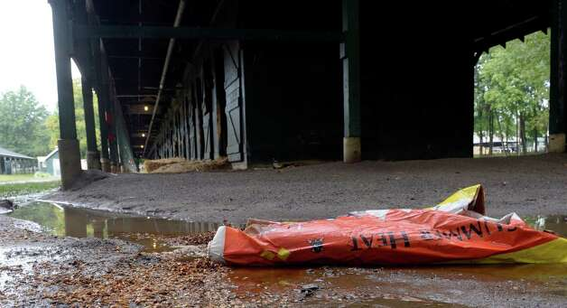 A partial bag of Summer Heat horse feed lies on the ground near an empty barn as the 150th meeting comes to a close Sept. 2, 2013,  at the Saratoga Race Course in Saratoga Springs, N.Y.  (Skip Dickstein/Times Union) Photo: SKIP DICKSTEIN