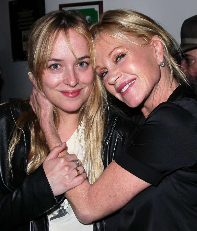 "Actress Dakota Johnson (L) and mother actress Melanie Griffith pose at the opening night of ""No Way Around But Through"" at the Falcon Theatre on June 3, 2012 in Burbank, California.  (Photo by David Livingston/Getty Images) Photo: David Livingston, Getty Images"