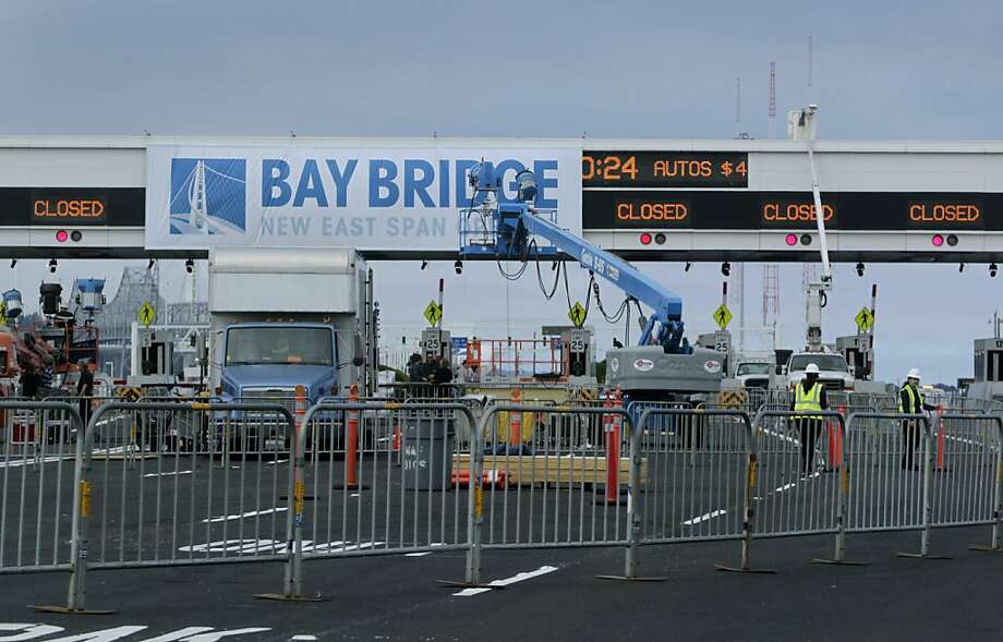 Final preparations are made at the Bay Bridge toll plaza in Oakland, Calif. for the official chain-cutting ceremony on Monday, Sept. 2, 2013 to celebrate the new span's opening.  Photo: Paul Chinn, The Chronicle