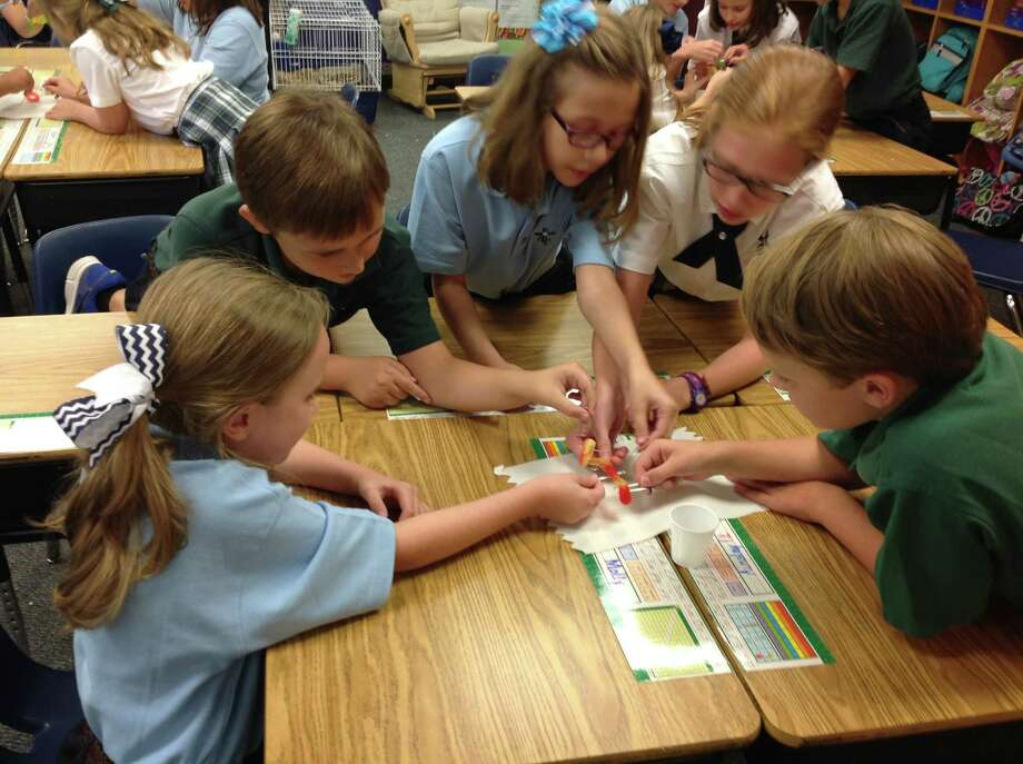 St. Anthony of Padua Catholic School students collaborate to save Fred the Worm in a creative thinking activity. Photo: Provided By St. Anthony Of Padua Catholic School
