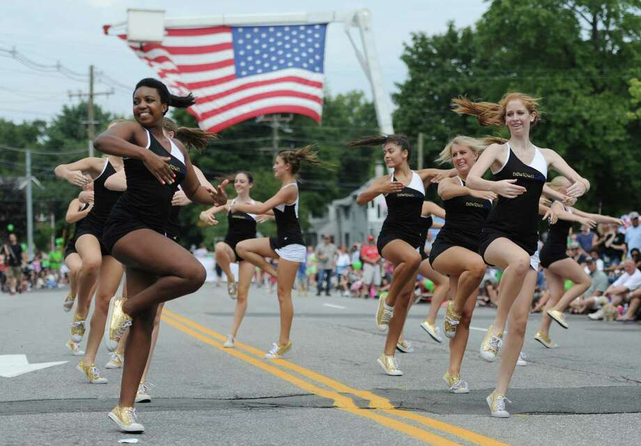 "The Newtown High School dance team performs at the end of the 52nd Annual Newtown Labor Day Parade in Newtown, Conn. on Monday, Sept. 2, 2013.  About 100 floats and groups participated in the parade, themed ""We are Newtown - marching strong."" Photo: Tyler Sizemore / The News-Times"