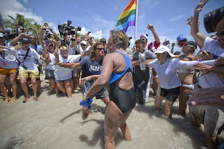 United States endurance swimmer Diana Nyad is greeted by a crowd as she walks on to the Key West, Fla., shore Monday, Sept. 2, 2013, becoming the first person to swim from Cuba to Florida without the help of a shark cage. Nyad arrived at the beach just before 2 p.m. EDT, about 53 hours after she began her swim in Havana on Saturday.  Photo: J Pat Carter, Associated Press