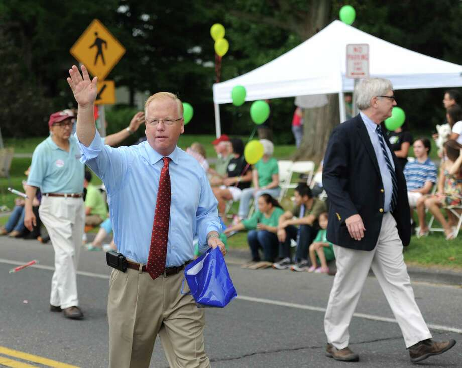 "Danbury Mayor Mark Boughton waves to the crowd while walking in the 52nd Annual Newtown Labor Day Parade in Newtown, Conn. on Monday, Sept. 2, 2013.  About 100 floats and groups participated in the parade, themed ""We are Newtown - marching strong."" Photo: Tyler Sizemore / The News-Times"