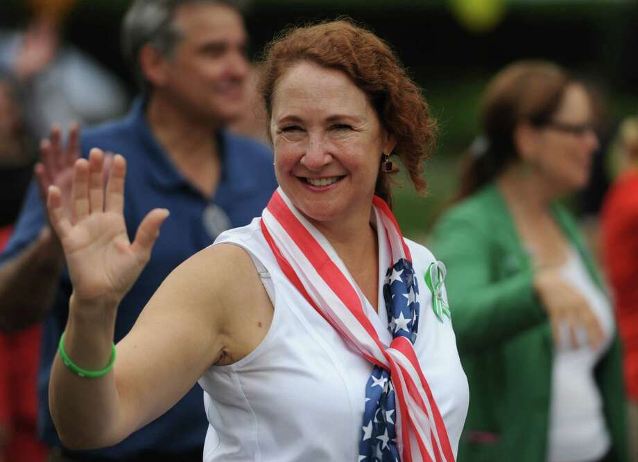 "U.S. Rep. Elizabeth Etsy waves to the crowd while walking in the 52nd Annual Newtown Labor Day Parade in Newtown, Conn. on Monday, Sept. 2, 2013.  About 100 floats and groups participated in the parade, themed ""We are Newtown - marching strong."" Photo: Tyler Sizemore / The News-Times"