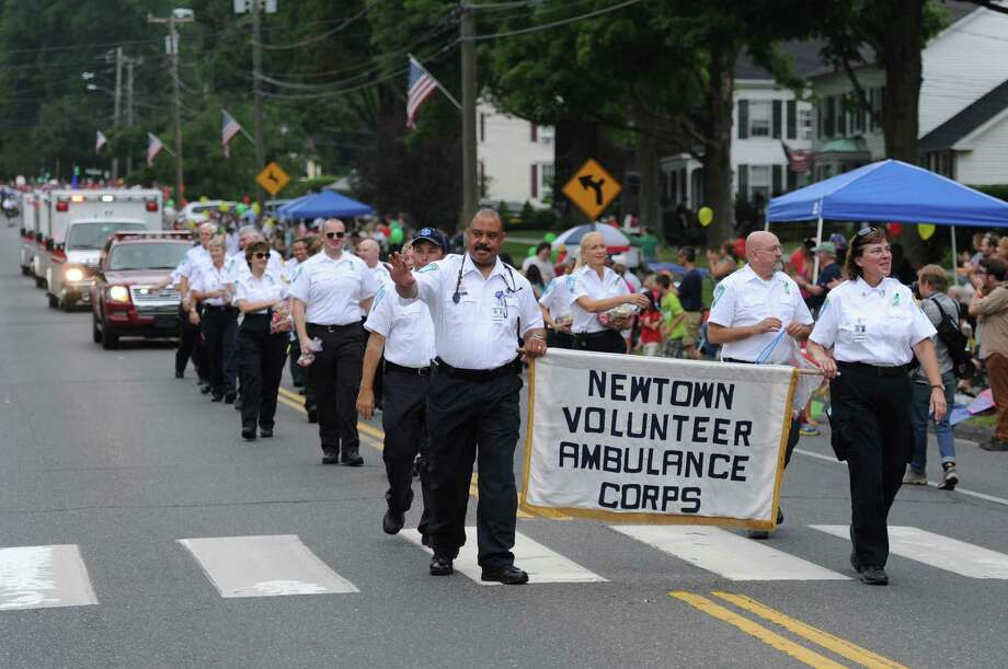 "The Newtown Volunteer Ambulance Corps march in the 52nd Annual Newtown Labor Day Parade in Newtown, Conn. on Monday, Sept. 2, 2013.  About 100 floats and groups participated in the parade, themed ""We are Newtown - marching strong."" Photo: Tyler Sizemore / The News-Times"