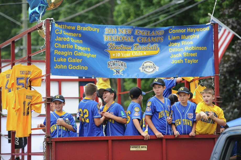 "Photos from the 52nd Annual Newtown Labor Day Parade in Newtown, Conn. on Monday, Sept. 2, 2013.  About 100 floats and groups participated in the parade, themed ""We are Newtown - marching strong."" Photo: Tyler Sizemore / The News-Times"