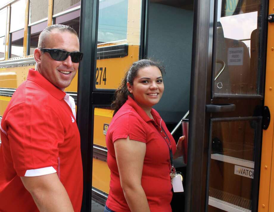Terry High School educators Eric Soehnge and Marlayna Shaw board a bus to visit Rosenberg neighborhoods. Photo: Provided By Terry High School