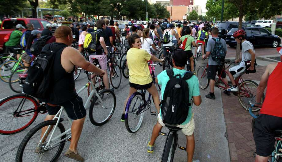 The Critical Mass bike ride starts around 7 p.m. on the last Friday of the month at downtown's Market Square Park. Photo: Karen Warren, Staff / © 2013 Houston Chronicle
