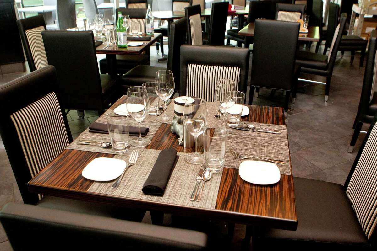NATIONAL NUMBER Americans reported eating out at lunch or dinner an average 4.5 times per week. Pictured: Morton's Grille in the Woodlands.