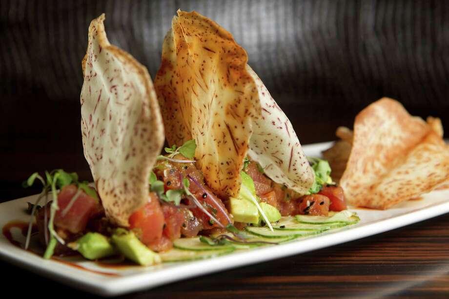 "Tuna Poke: Spicy ""Ahi"" tuna, avacado, sesame, soy caramel at Morton's Grille Wednesday, Aug. 28, 2013, in The Woodlands. ( Johnny Hanson / Houston Chronicle ) Photo: Johnny Hanson, Staff / © 2013  Houston Chronicle"