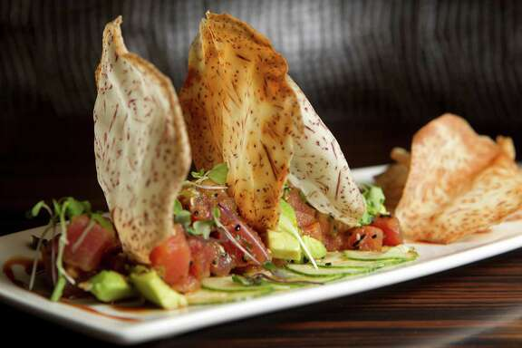 "Tuna Poke: Spicy ""Ahi"" tuna, avacado, sesame, soy caramel at Morton's Grille Wednesday, Aug. 28, 2013, in The Woodlands. ( Johnny Hanson / Houston Chronicle )"