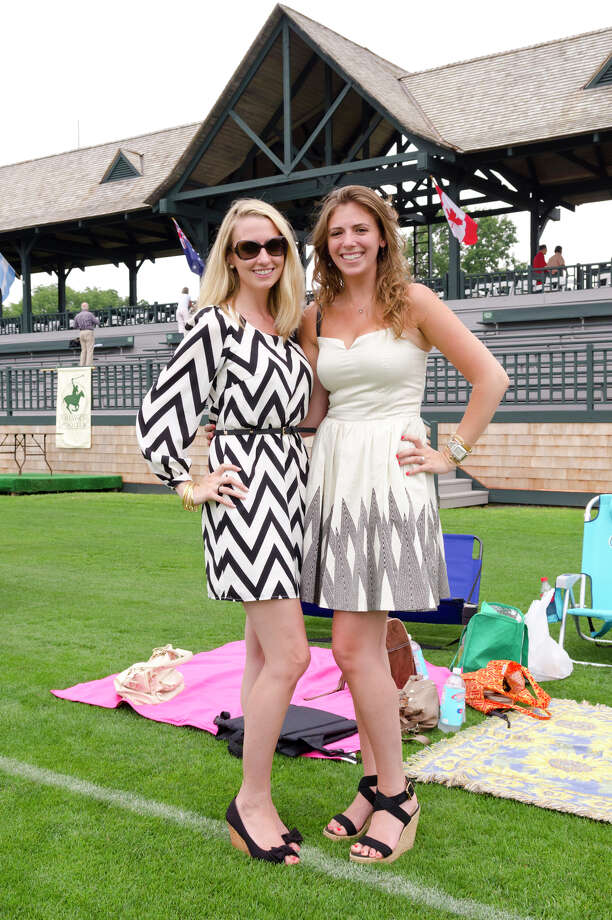 Cate Liverman, of Virginia, at left, and Lindsay Olzerowicz, of Weehawken, NJ, at the Greenwich Polo Club on Sunday, Sept. 1, 2013. Liverman is wearing a black and white chevron My Michelle dress with 3/4 length sleeves, black peep-toe kitten wedge shoes by American Eagle, Stella & Dot gold bangles and Tory Burch sunglasses. Olzerowicz is wearing a dress by Armani Exchange, a watch by Michelle, a kiss bangle by Tiffany's, and woven espadrilles wedges. Photo: Amy Mortensen / Connecticut Post Freelance