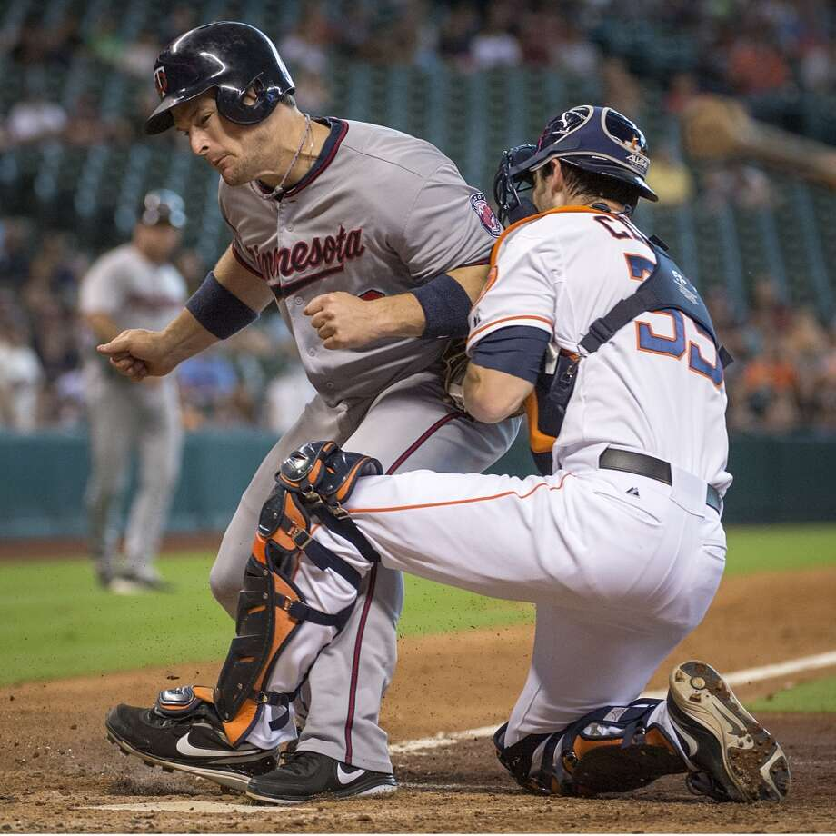 Sept. 2: Twins 10, Astros 6  Astros catcher Cody Clark holds on for the tag as Twins designated hitter Josh Willingham is out at home trying to score on a single by Chris Herrmann during the fifth inning. Photo: Smiley N. Pool, Chronicle