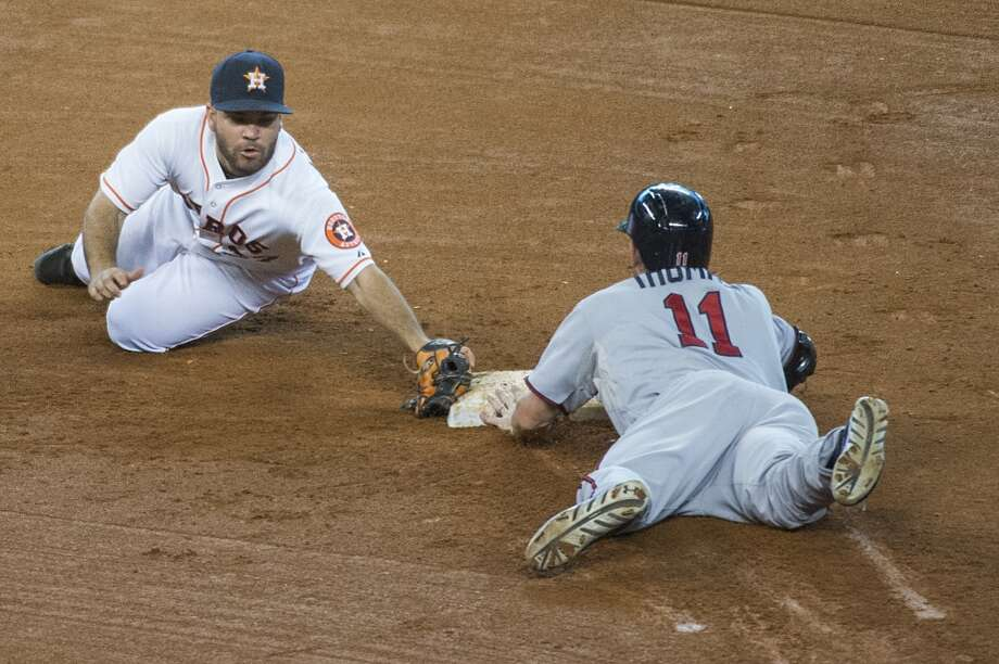 Twins outfielder Clete Thomas is safe at second base as Astros second baseman Jose Altuve tries to make the play as he advanced on a fielding error by center fielder Brandon Barnes during the fourth inning. Photo: Smiley N. Pool, Chronicle