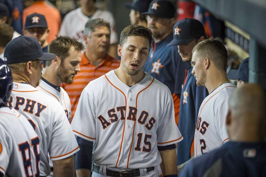 Astros catcher Jason Castro departs the game due to a knee injury after an RBI single in the second inning. Photo: Smiley N. Pool, Chronicle