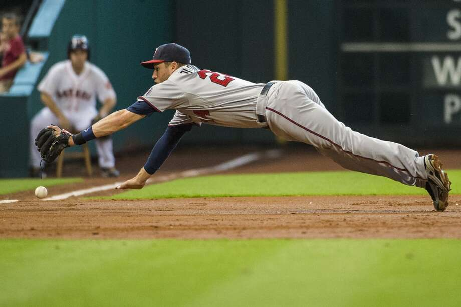 Twins third baseman Trevor Plouffe can't make the play as he dives for an RBI single off the bat of Jason Castro during the second inning. Photo: Smiley N. Pool, Chronicle
