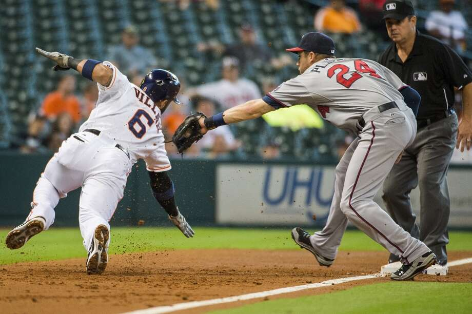 Twins third baseman Trevor Plouffe applies the tag as Jonathan Villar is caught off third base during the second inning. Photo: Smiley N. Pool, Chronicle