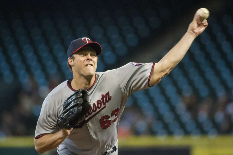 Twins starting pitcher Andrew Albers works during the first inning. Photo: Smiley N. Pool, Chronicle
